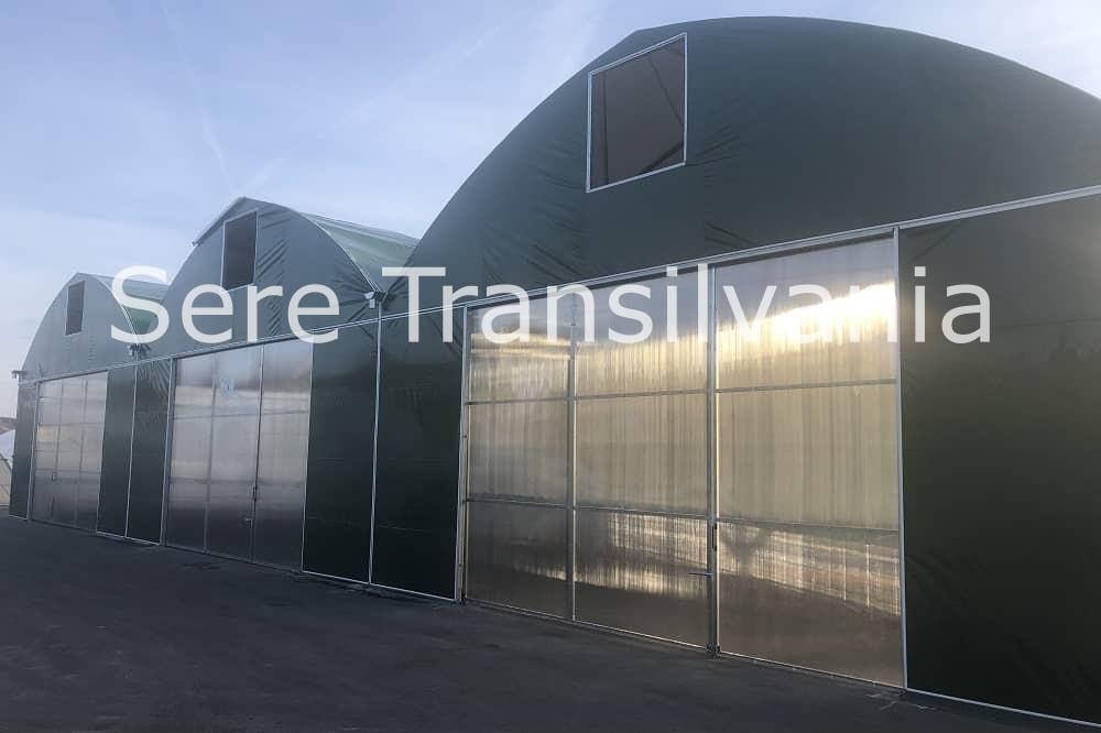 corturi industriale modulare acoperite cu folie verde